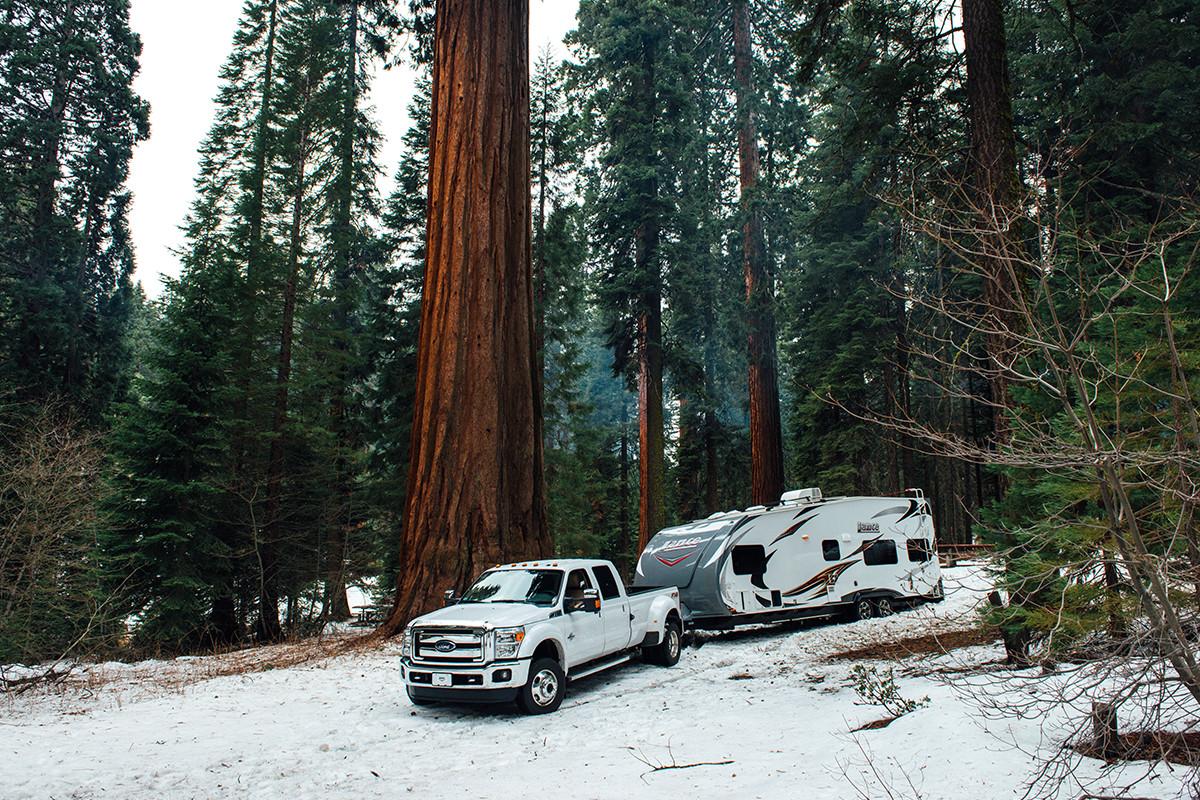 travel trailer in snow winter winterizing rv winterization