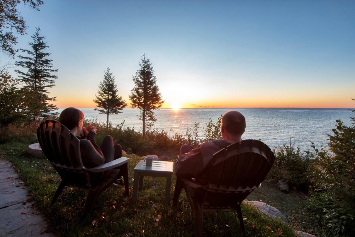 couple sitting on chairs at the shores of a Minnesota lake