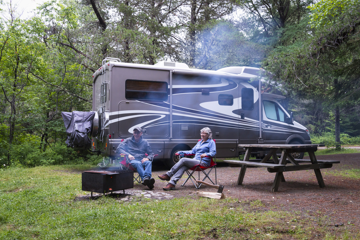 Couple sitting in front of their RV