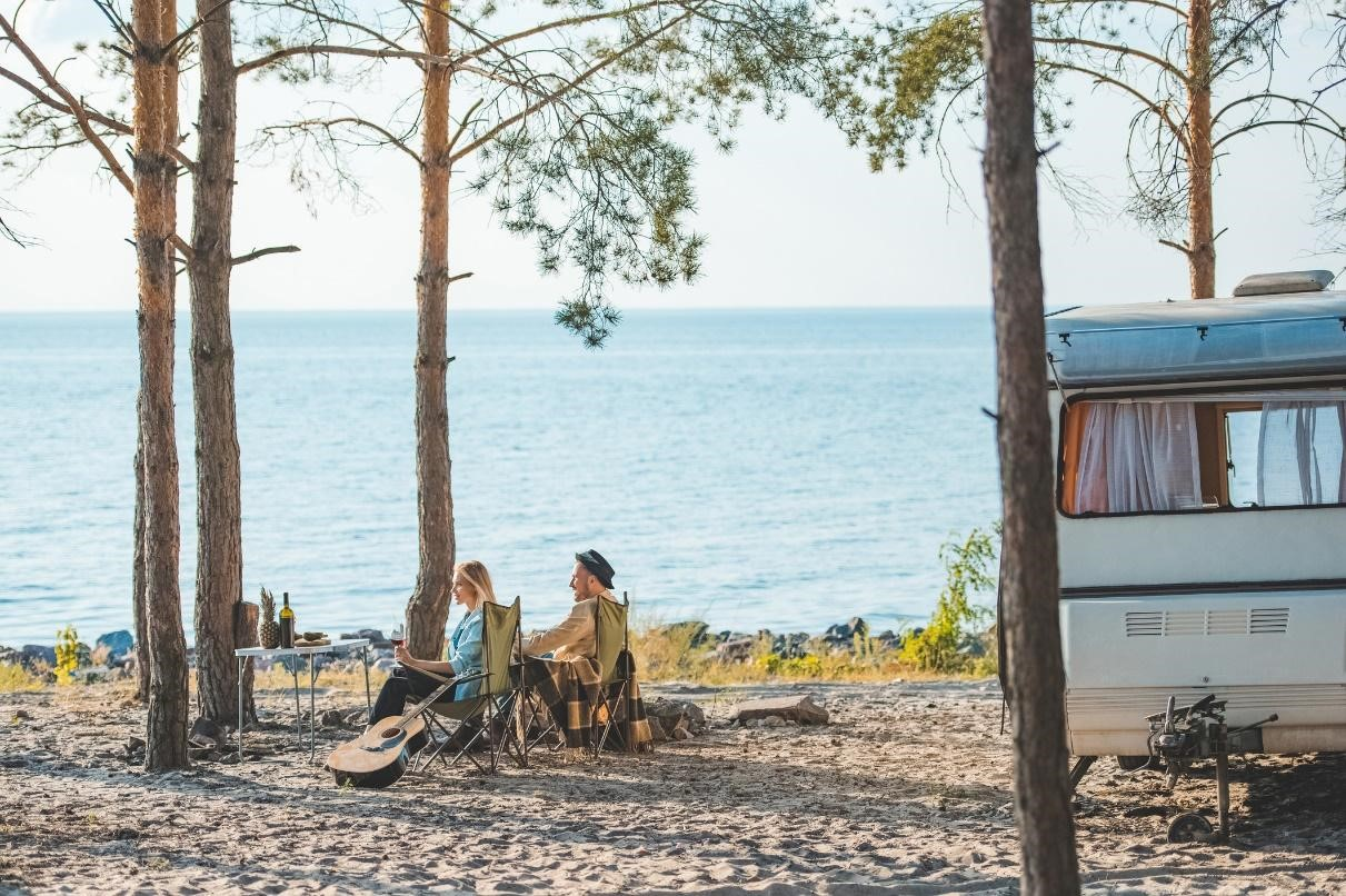Couple RV camping at a beach